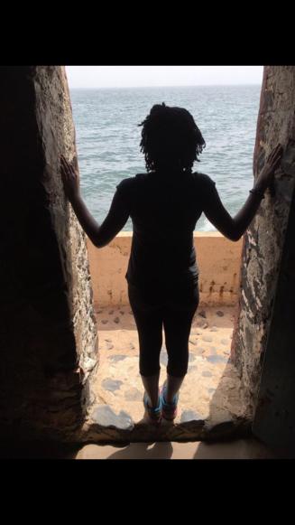 My daughter standing in the Door of No Return