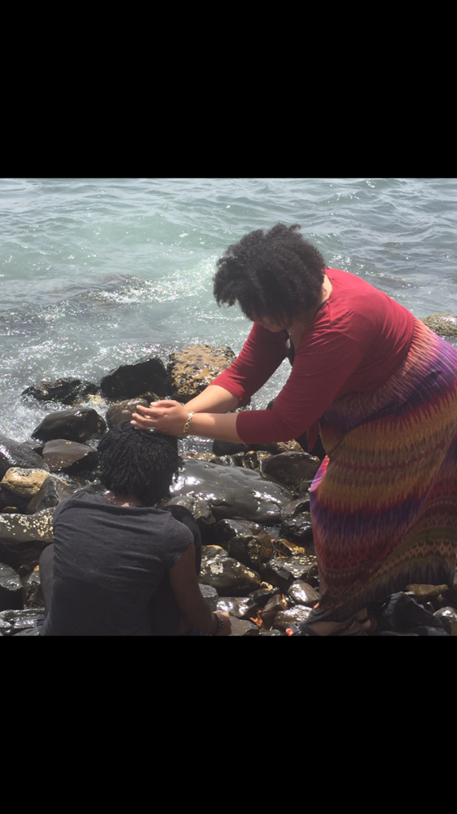 My daughter being blessed in the waters