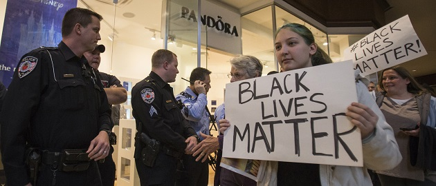 Protesters, demanding justice for the killing of 18-year-old Michael Brown, interrupt Black Friday shopping while marching through the St. Louis Galleria Mall in Missouri